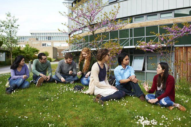 Postgraduate students sitting outside the Berrick Saul Building  Taken in 2015 as part of the Postgraduate 2016 Prospectus.